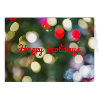 Defocused Christmas tree lights with greeting Greeting Card