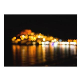 Defocused night skyline of a coastal city card