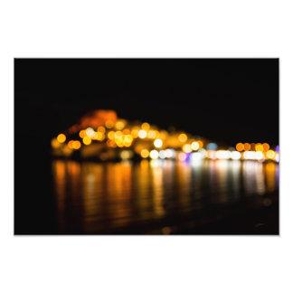 Defocused night skyline of a coastal city photo print