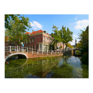 Delft, canal, bridge, and old houses postcard