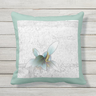 Delicate green plant on pale teal background cushion
