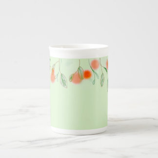 Delicate gum leaves and flowers on pastel green tea cup