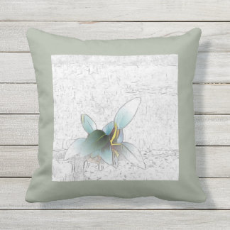 Delicate leaves on white brick garden wall outdoor cushion