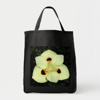 Delicate white orchid like flower grocery tote bag