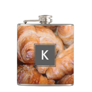 Delicious classic french croissants photograph hip flask