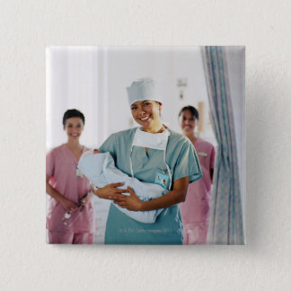 Delivery room nurse holding baby, nurses in 15 cm square badge