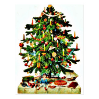 Deocrated christmas tree with gifts placed under postcard