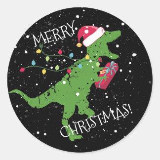 Derpy t-rex dinosaur Christmas lights Santa hat Classic Round Sticker
