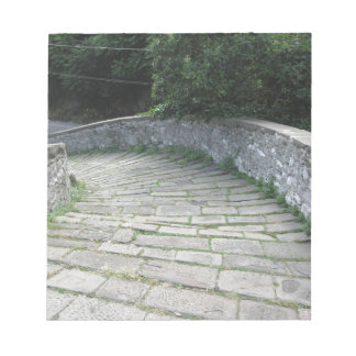 Descent stone walkway of medieval bridge notepad