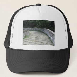 Descent stone walkway of medieval bridge trucker hat
