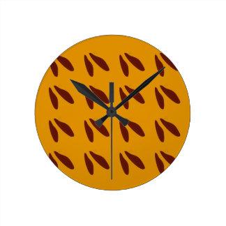 Design beans on gold round clock