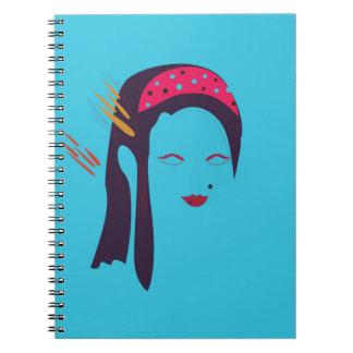 Design Geisha on blue Notebook
