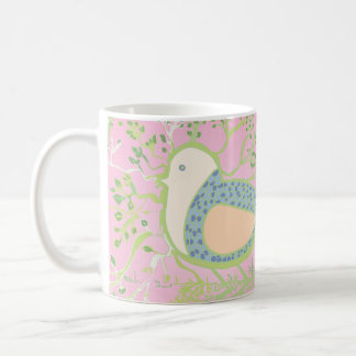 Design of a bird surrounded by tree with branches coffee mug