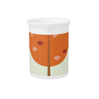 Designers orange tree on green pitcher