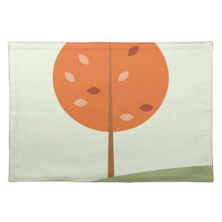 Designers orange tree on green placemat