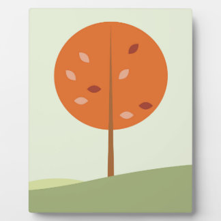 Designers orange tree on green plaque