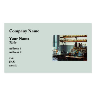 Desk With Bottles of Chemicals Business Card Templates