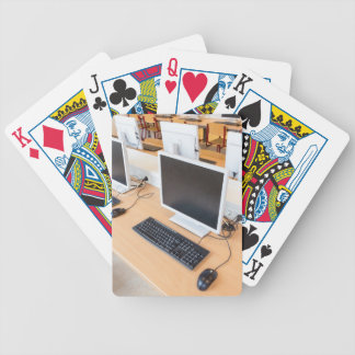 Desktop computer in computer class on school bicycle playing cards