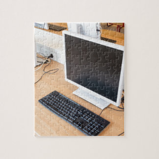 Desktop computer in computer class on school jigsaw puzzle