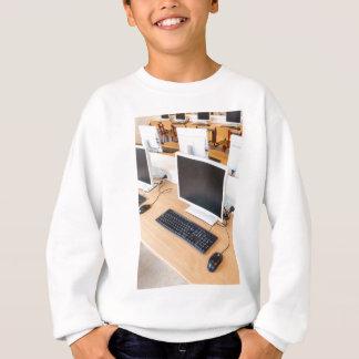 Desktop computer in computer class on school sweatshirt