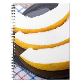 Dessert of sweet yellow melon slices spiral notebooks
