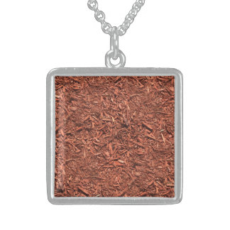 detail image of red cedar mulch for gardener sterling silver necklace