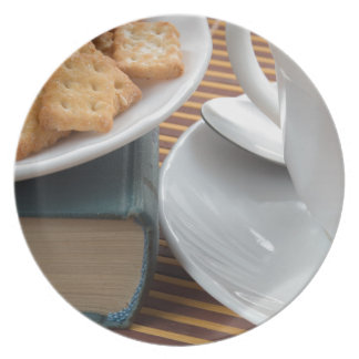 Detail of a cup of tea and a plate of crackers