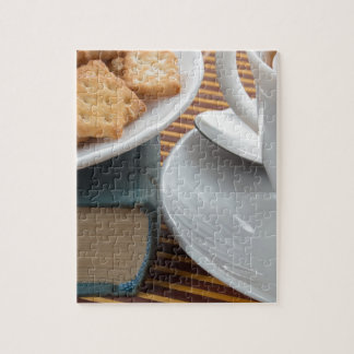 Detail of a cup of tea and a plate of crackers jigsaw puzzle