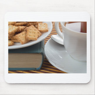 Detail of a cup of tea and a plate of crackers mouse pad