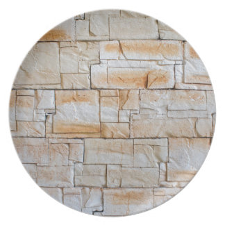 Detail of a decorative wall of limestone tiles dinner plates