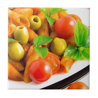 Detail of a plate closeup Italian pasta penne Ceramic Tile