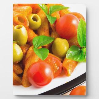 Detail of a plate closeup Italian pasta penne Plaque