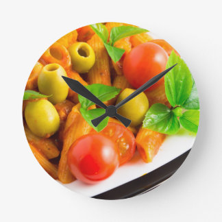Detail of a plate closeup Italian pasta penne Round Clock
