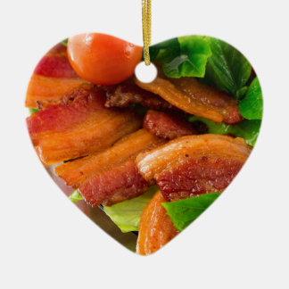 Detail of a plate of fried bacon and cherry tomato ceramic ornament