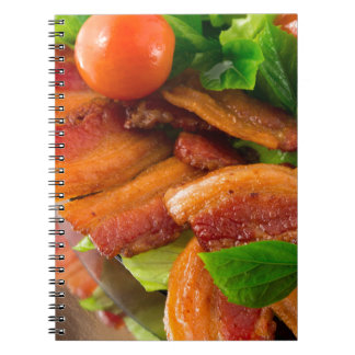 Detail of a plate of fried bacon and cherry tomato spiral notebook