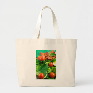 Detail of a plate with cherry tomatoes, herbs large tote bag