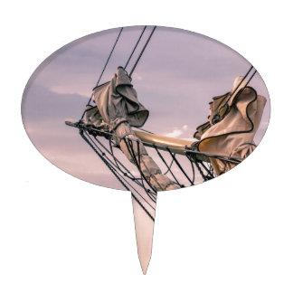 Detail of a sailing ship cake pick