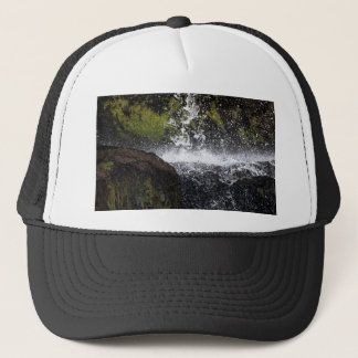 Detail of a small waterfall trucker hat