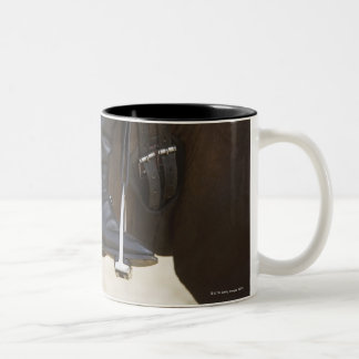 detail of female dressage rider on horse Two-Tone coffee mug