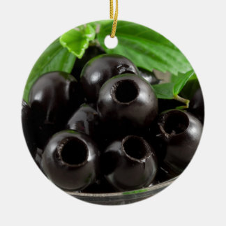 Detailed close-up view of the black olives ceramic ornament