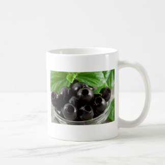 Detailed close-up view of the black olives coffee mug