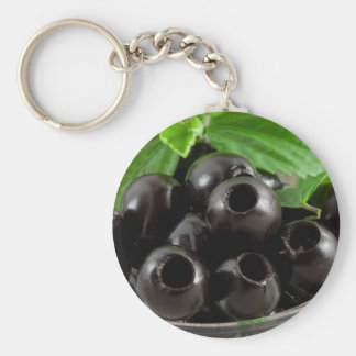Detailed close-up view of the black olives key ring