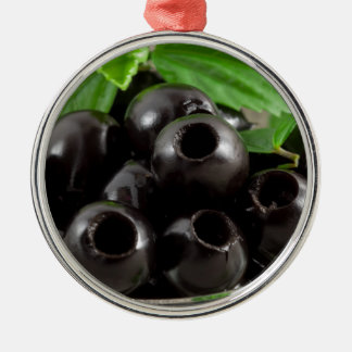 Detailed close-up view of the black olives metal ornament