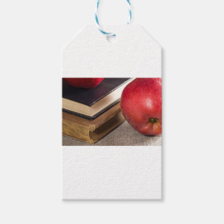 Detailed close-up view of the red apples and old gift tags