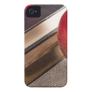 Detailed close-up view of the red apples and old iPhone 4 Case-Mate case