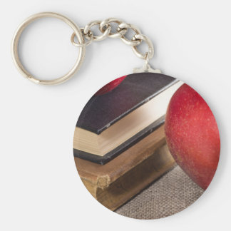 Detailed close-up view of the red apples and old key ring