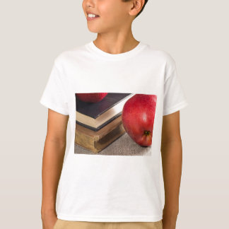 Detailed close-up view of the red apples and old T-Shirt