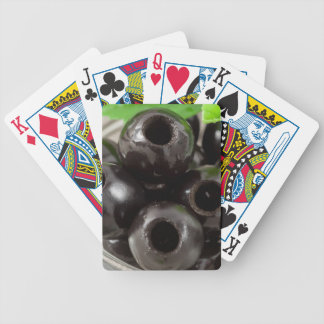 Detailed macro view of the black olives bicycle playing cards