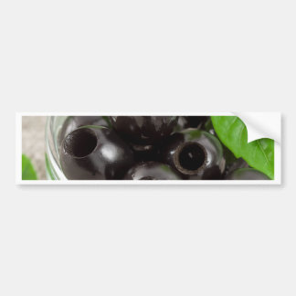 Detailed macro view of the black olives bumper sticker