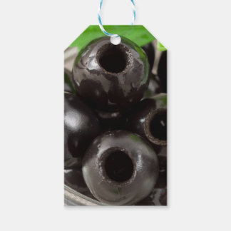 Detailed macro view of the black olives gift tags